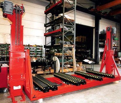 Two pillar lifting unit · electrical synchronized without shaft ·  with telescopic forks.